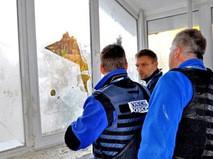 Представители ОБСЕ на месте обстрела жилых районов Донбасса