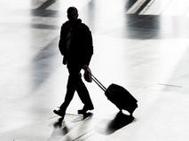Пассажир с чемоданом