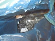 Бутылки из-под суррогатного алкоголя, изъятые с места происшествия