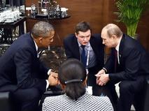 Президент России Владимир Путин беседует с президентом США Бараком Обамой