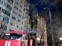 Сотрудники МЧС России у разрушенного в результате взрыва бытового газа многоэтажного дома в Волгограде