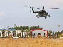 Вертолет ВКС России над авиабазой в Сирии