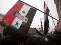 Флаг Сирии с портретом президента Башара Асада