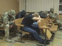 Сотрудники охранного предприятия, задержанные после перестрелки в гостинице в Одессе