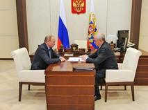 Президент России Владимир Путин и глава таможенной службы Владимир Булавин
