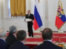 Президент РФ Владимир Путин выступает во время ежегодного торжественного приёма в Кремле по случаю празднования Дня Героев Отечества