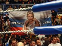 Флаг с портретом Натальи Рагозиной на трибуне