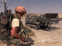 Инженерная бронетехника во время мероприятий по разминированию сирийского города Дейр-эз-Зор