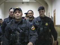 Режиссер Кирилл Серебренников под конвоем в суде