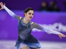 Россйиская фигуристка Евгения Медведева выступает в короткой программе женского одиночного катания на соревнованиях по фигурному катанию на XXIII зимних Олимпийских играх
