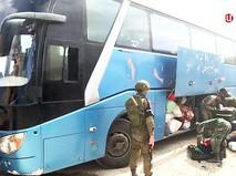 Выход боевиков из зоны боевых действий в Сирии