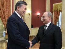 Президент России Владимир Путин (справа) и президент Украины Виктор Янукович во время официального приема от имени главы Российского государства в честь высокопоставленных гостей XXII зимних Олимпийских игр