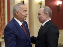 Президент России Владимир Путин (справа) и президент Узбекистана Ислам Каримов во время официального приема от имени главы Российского государства в честь высокопоставленных гостей XXII зимних Олимпийских игр