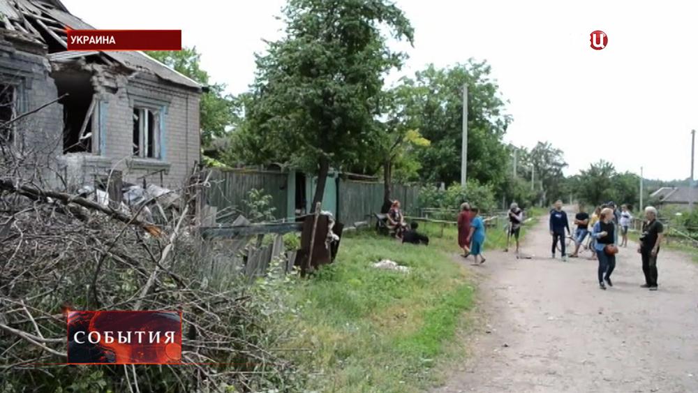 Последствия обстрела украинскими войсками жилых домов