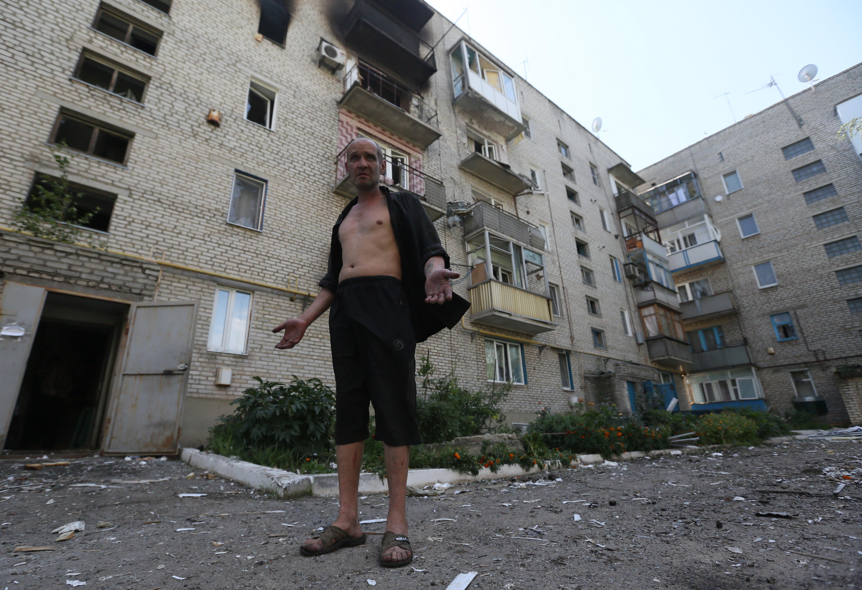 Жилой дом, пострадавший в результате артиллерийского обстрела