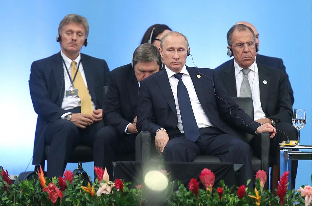 Дмитрий Песков, Юрий Ушаков, Владимир Путин и Сергей Лавров во время саммита