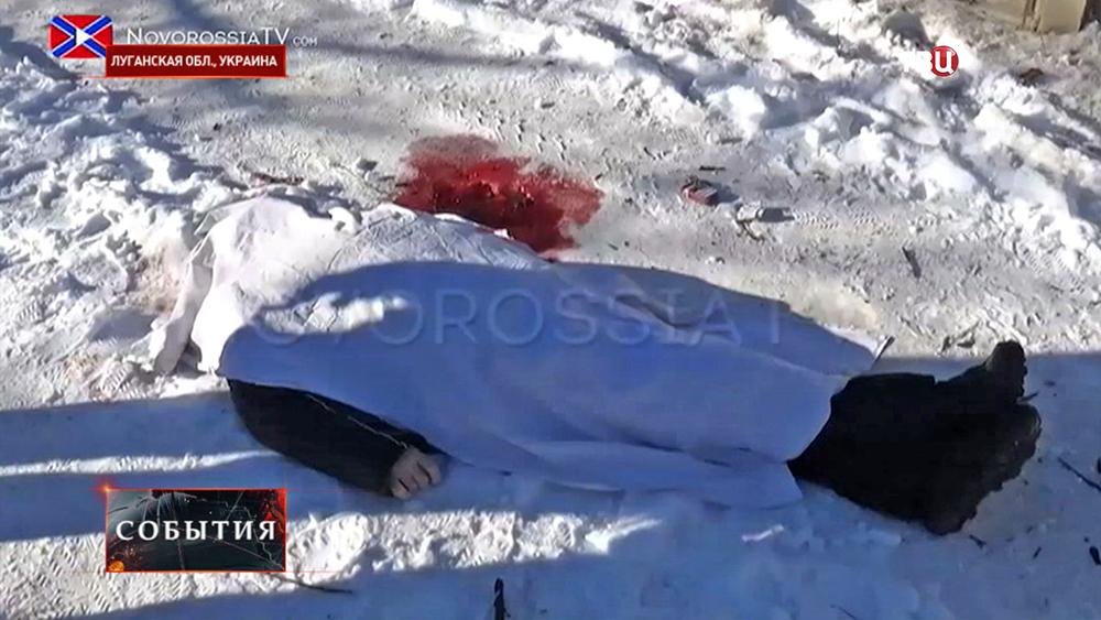 Погибший при обстреле жилых кварталов в Донецкой области
