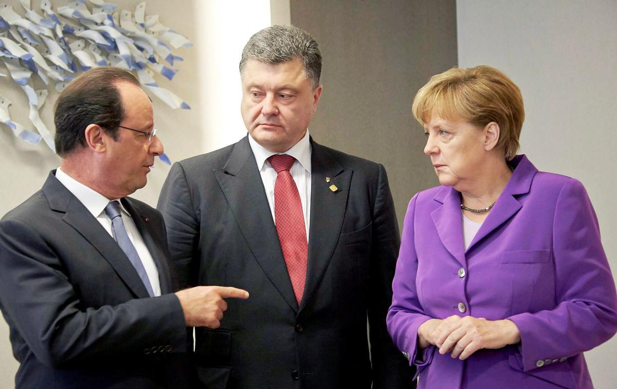 Президент Франции Франсуа Олланди, президент Украины Петр Порошенко и канцлер Германии Ангела Меркель