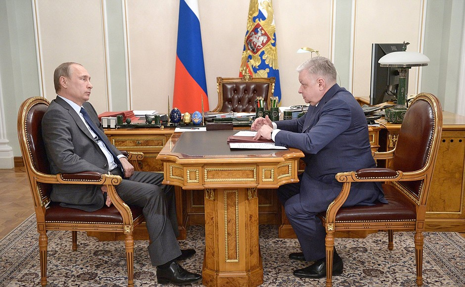 Президент России Владимир Путин и директор ФМС Константин Ромодановский