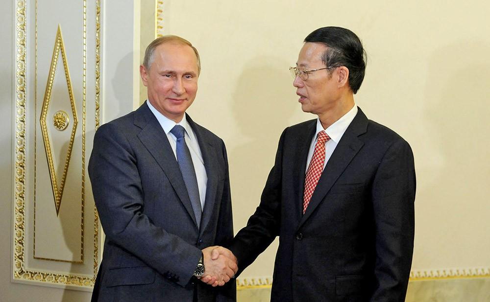 Президент России Владимир Путин и первый заместитель Премьера Государственного Совета Китая Чжан Гаоли
