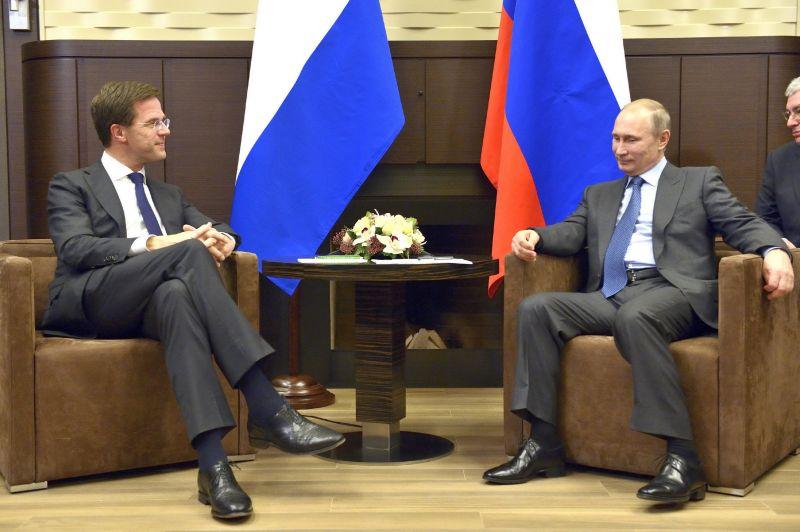 Владимир Путин и Марк Рютте на встрече перед церемонией открытия Сочи-2014