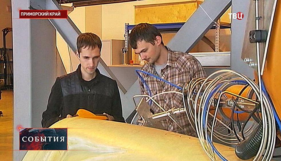 Работа робота на авиазаводе по производству вертолётов
