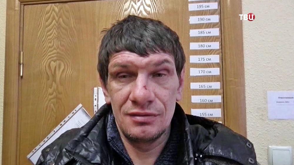 Задержанный член банды грабителей