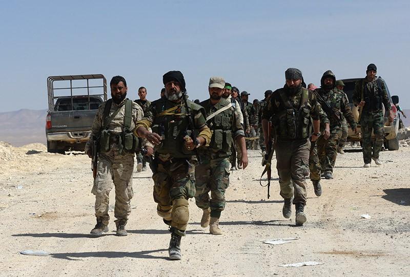 Бойцы сирийской армии во время наступления