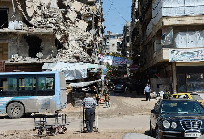 Разрушенные дома в городе Алеппо