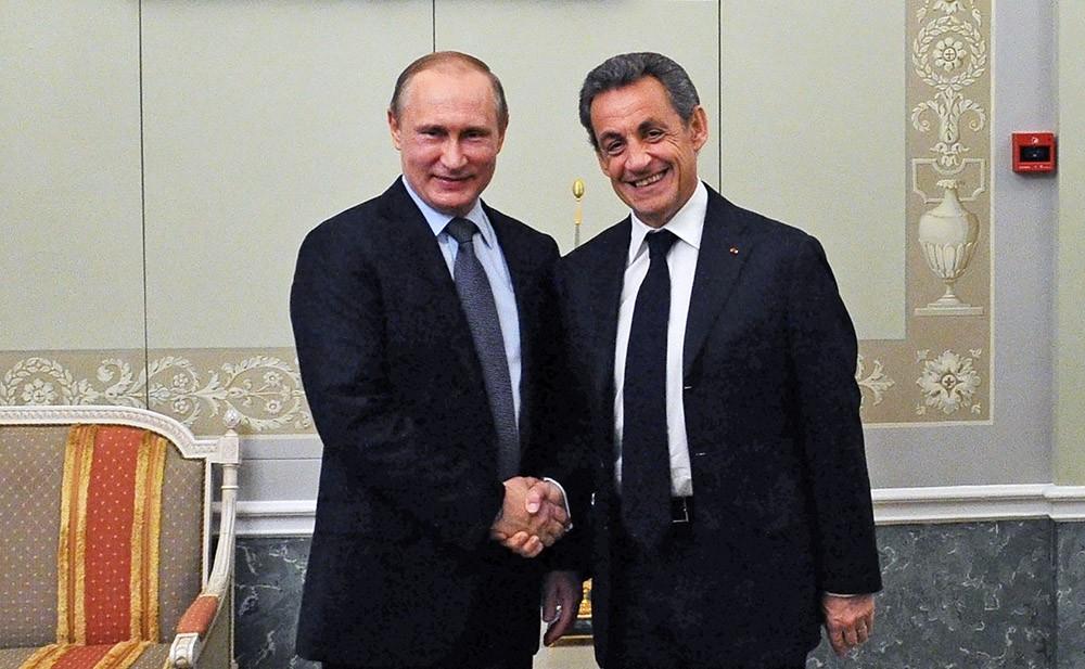 Президент России Владимир Путин и бывшим президентом Франции Николя Саркози