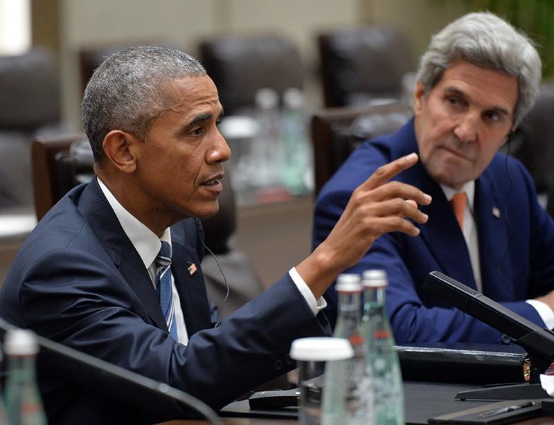 Президент США Барак Обама и государственный секретарь США Джон Керри во время встречи в Ханчжоу с президентом РФ Владимиром Путиным