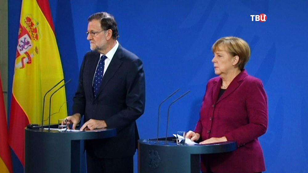 Ангела Меркель и Мариано Рахой