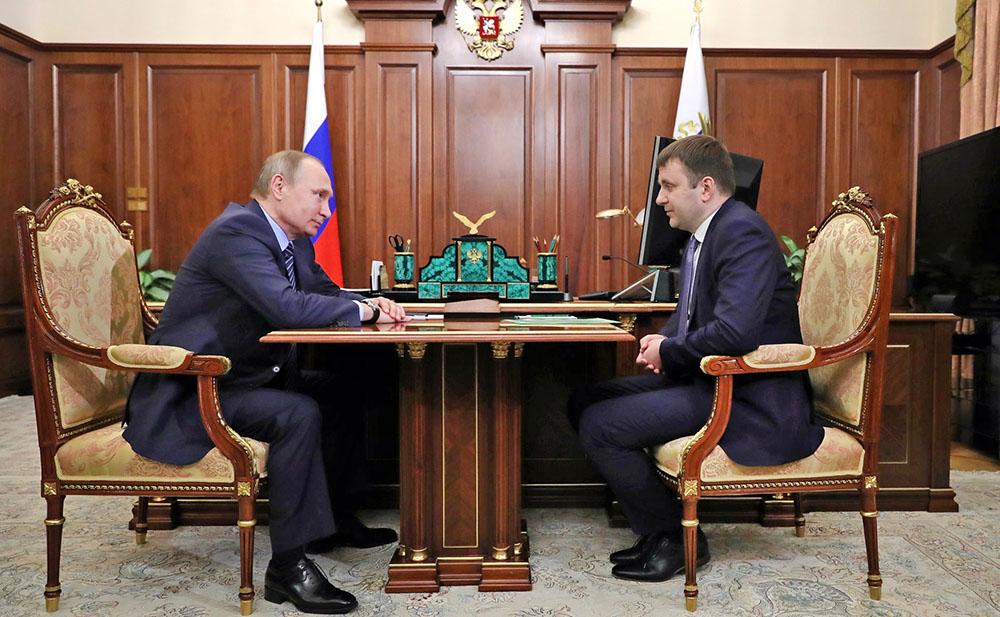 Президент России Владимир Путин и министр экономического развития Максим Орешкин