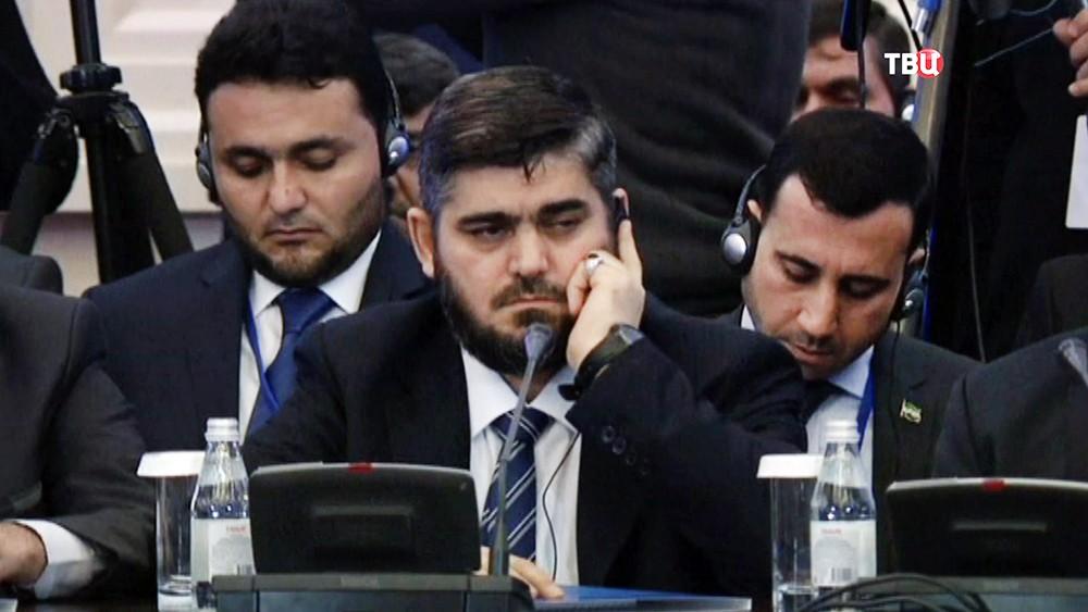 """Глава делегации сирийской оппозиции Мухаммед Аллуш из группировки """"Джейш аль-Ислам"""" на переговорах в Астане"""