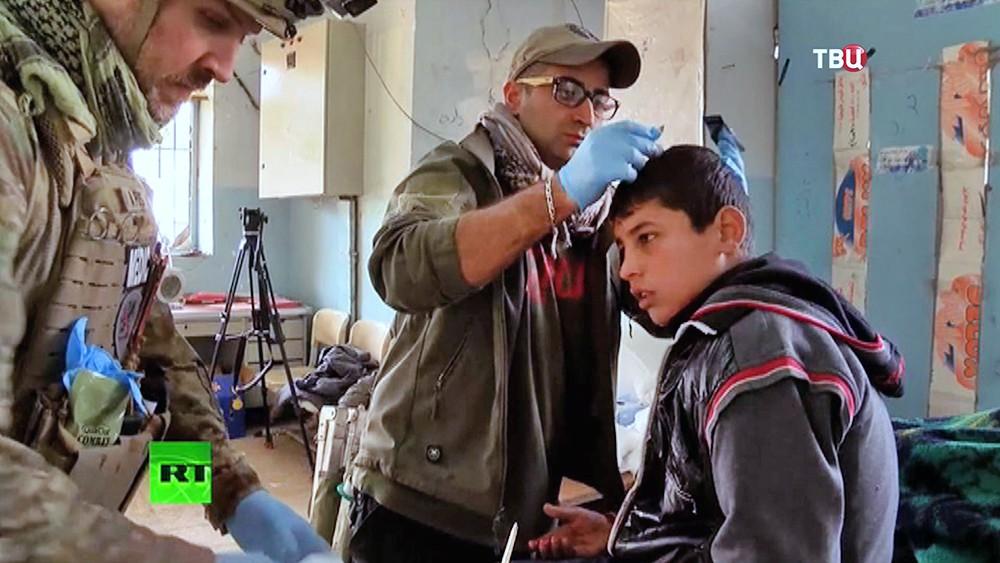 Пострадавшие при обстреле силами международной коалиции города в Ираке