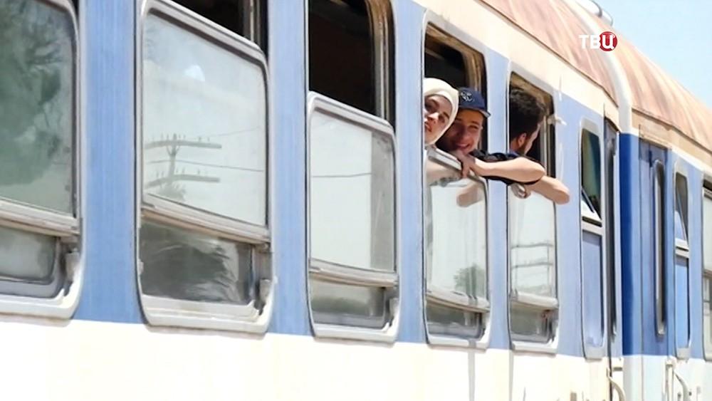 Пассажиры поезда в Сирии