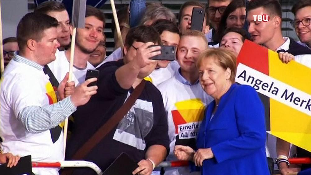 Сторонники политики Ангелы Меркель