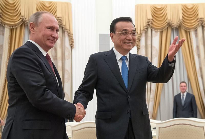 Президент РФ Владимир Путин и премьер КНР Ли Кэцян