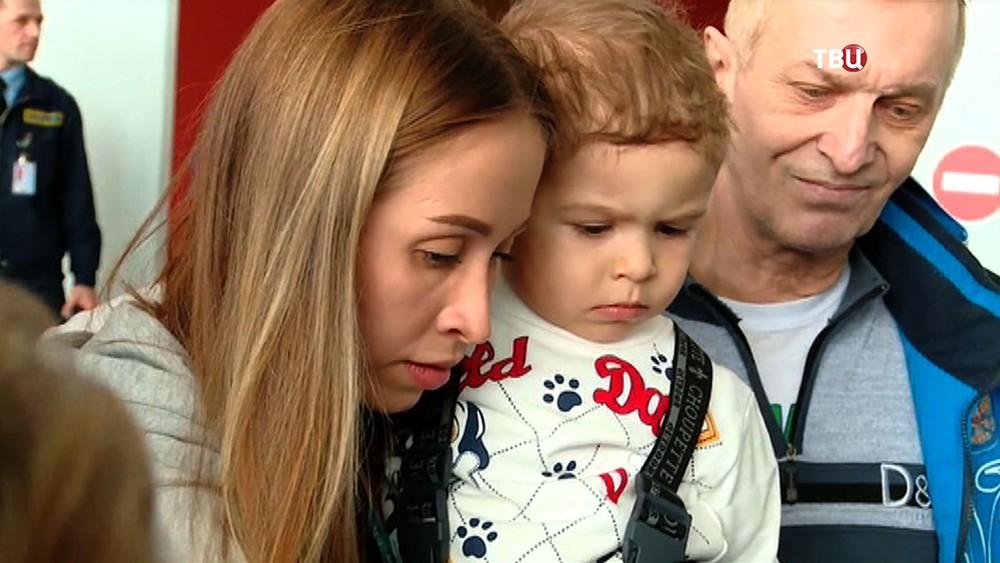 Паралимпийская спортсменка Михалина Лысова с сыном