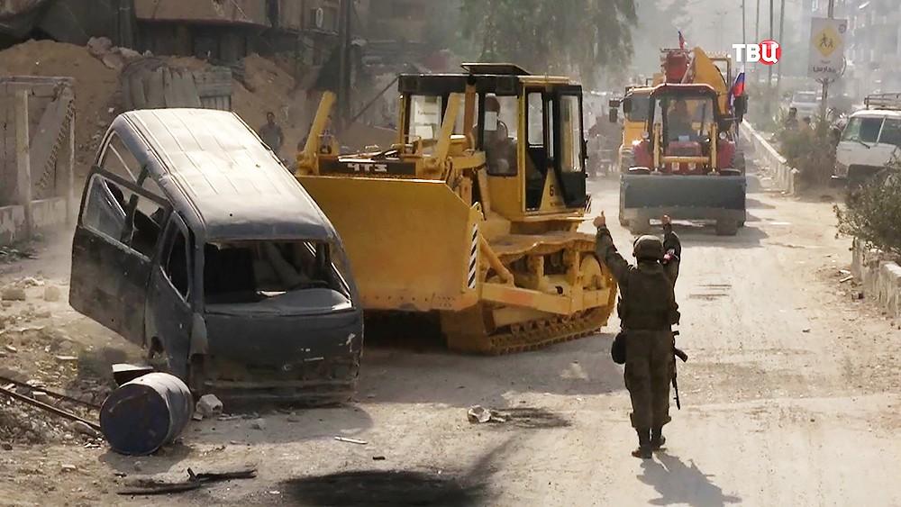 Строительная техника ликвидирует последствия военных действий в Сирии