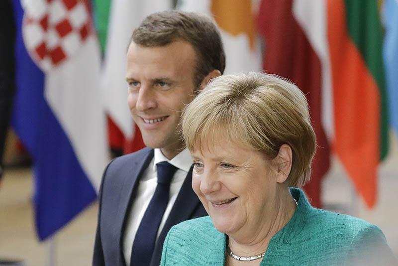 Эмманюэль Макрон и Ангела Меркель на саммите ЕС в Брюсселе