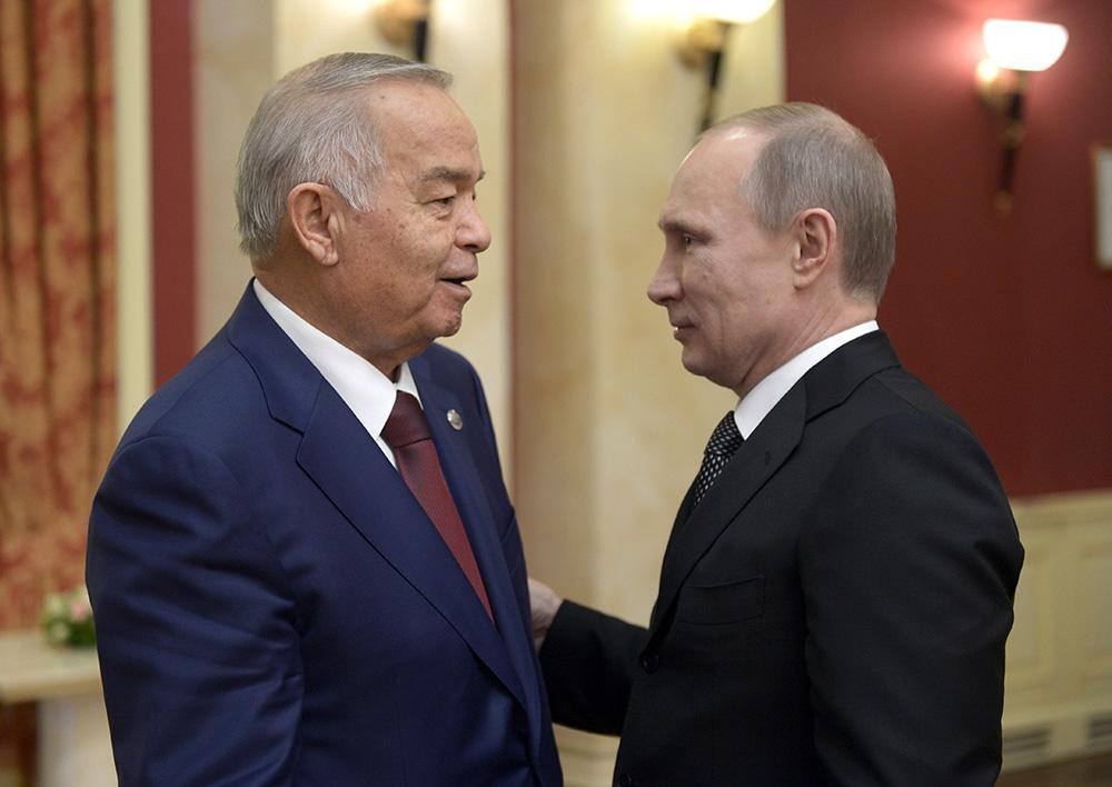 Президент России Владимир Путин (справа) и президент Узбекистана Ислам Каримов