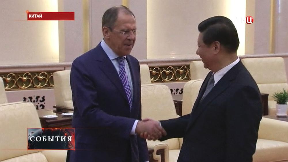Глава МИД РФ Сергей Лавров и председатель КНР Си Цзиньпин