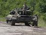 Бойцы ополчения на танке Т-64 в районе блокпоста в Луганской области