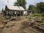 Жилой дом в Донецке Ростовской области, во дворе которого разорвался снаряд украинской армии