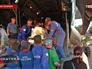 Врачи МЧС вынося из самолета кювез с младенцем