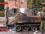 Бойцы народного ополчения ДНР возле подбитой бронетехники Нацгвардии Украины