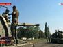 Ополченцы ДНР у захваченной военной техники