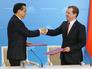 Премьер Государственного совета Китайской Народной Республики Ли Кэцян и премьер-министр РФ Дмитрий Медведев
