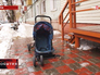 Разбитая от падения ледяной глыбы детская коляска